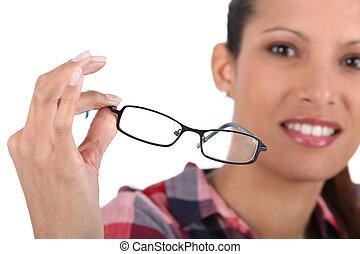 Brunette holding glasses