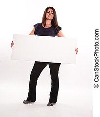 Brunette holding message board