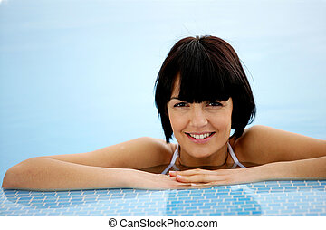 Brunette in a swimming pool