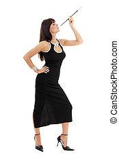 brunette in black dress with cigarette holder