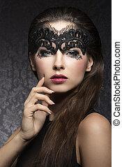 Brunette in black mask