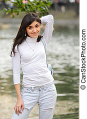 Brunette in casual at pond
