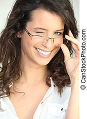 Brunette in glasses winking at the camera
