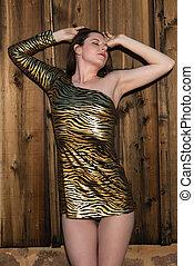 Brunette in gold animal print dress
