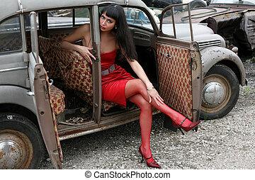 brunette in old car