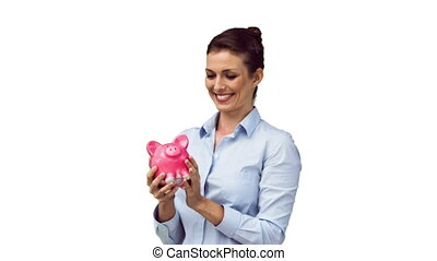 Brunette in slow motion throwing her piggy bank