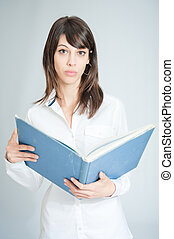 Brunette in white shirt with book