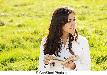 Brunette in white with book