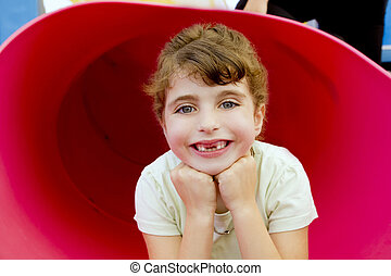 brunette indented girl smiling in red playground