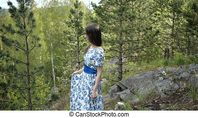 Brunette is taking a walk in the forest