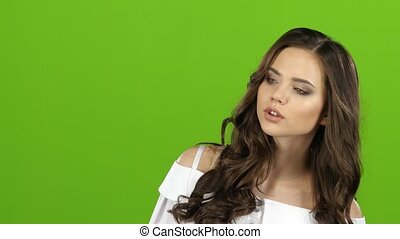 Brunette is waiting for the guy, she sees him waving and winking. Green screen. Close up