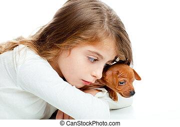 brunette kid girl with mini pinscher pet mascot dog