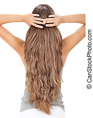 Brunette lady holding long hairs, view from back side ...