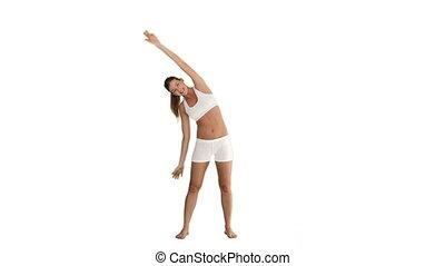 Brunette lady in sportswear doing exercise