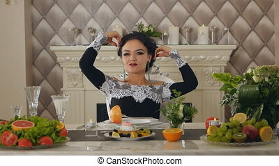 brunette lady model at a table with fruits posing on camera