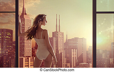 Brunette lady staring at beautiful sunrise - Brunette woman...