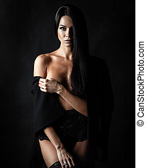 brunette lady with beautiful hair on black