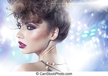 Brunette lady with fancy curly haircut