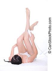 brunette laying on back shaving legs