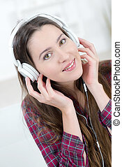 Brunette listening to music at home