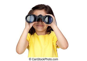 Brunette little girl looking through binoculars
