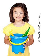 Brunette little girl with beach toys