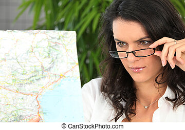 Brunette looking at map