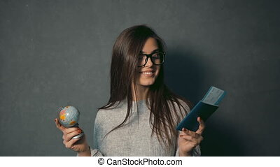 Brunette Looks at Globe and Passport