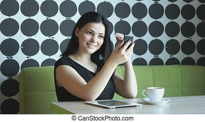 Brunette making selfie photo using a smartphone