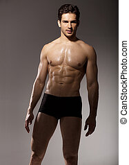 Brunette man with fit body