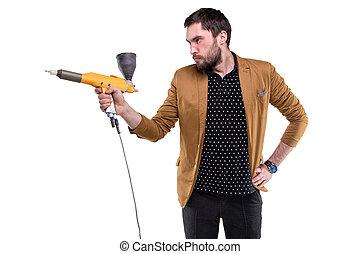 Brunette man with powder gun