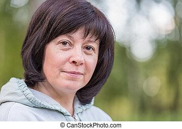 Brunette middle-aged - portrait of a middle-aged brunette...