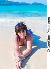 woman lying in the sea