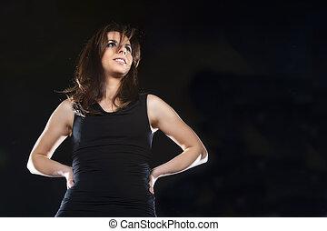 Brunette Model - A brunette model on an isolated black ...