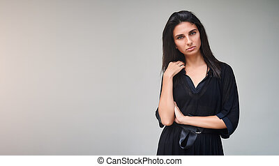 Brunette model girl wearing stylish black dress. Sexy woman portrait with perfect makeup, Beauty trends. panoramic photo