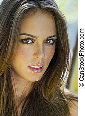 Brunette Model Outdoors - A brunette model posting in an ...