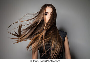Brunette model with windy hair - Portrait of calm...