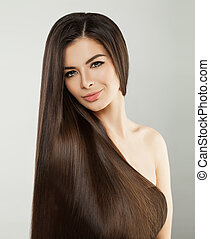 Brunette Model Woman with Long Healthy Hair style and Perfect Makeup