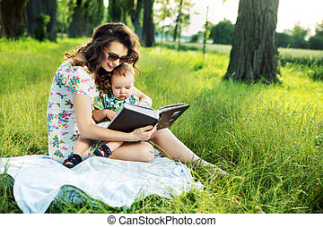 Brunette mother reading a fairy tale for her child