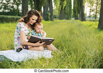 Brunette  mother reading tales for her child