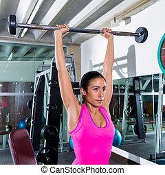 brunette narrow grip barbell shoulder press workout at gym