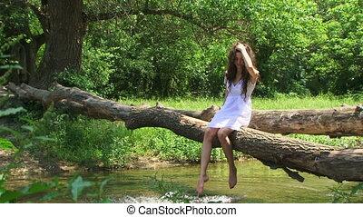 Brunette on a riverside