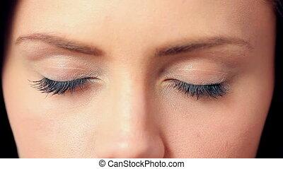 Brunette opening her blue eyes