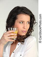 Brunette orange juice
