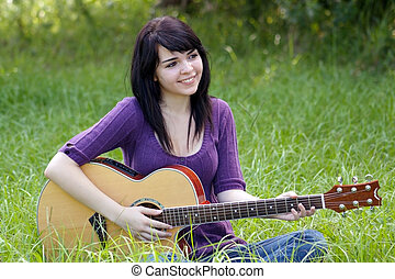 Brunette Outdoors with a Guitar (1)