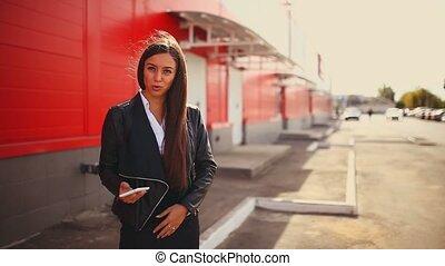 brunette outraged swears girl in street talking on phone...