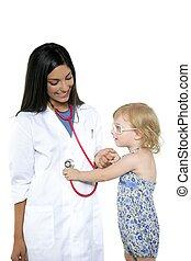 Brunette pediatric doctor with blond little girl