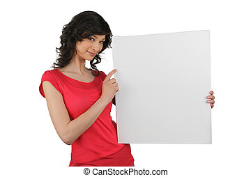 Brunette pointing to blank advertising board