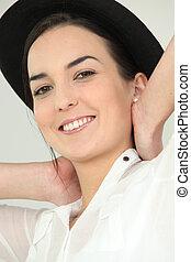 Brunette posing in hat
