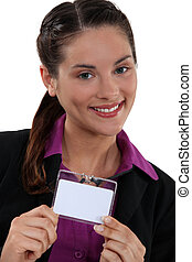 Brunette proudly displaying her business pass